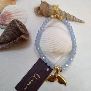 Stretch whale tail bracelet. Mexican braceletd
